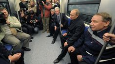 Pool photo by Alexei Druzhinin  Tags: Russia, Moscow, Vladimir Putin  8/30/2012  Russian President Vladimir Putin, second from right, rides in a subway car as he examines a new Novokosinosubway station in Moscow.