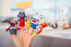 Finger puppets. http://www.karaspartyideas.com/2010/09/real-party-robot-birthday.html