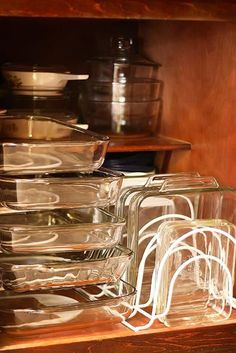 Use pan organizers both horizontally & vertically to maximize storage space in your kitchen cabinets.