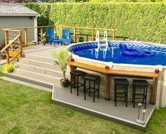 Above ground salt water pool and deck with bar area. Above Ground Pool Landscaping, Above Ground Pool Decks, Backyard Pool Landscaping, Backyard Patio Designs, In Ground Pools, Oberirdische Pools, Cool Pools, Decks Around Pools, Pool Deck Plans