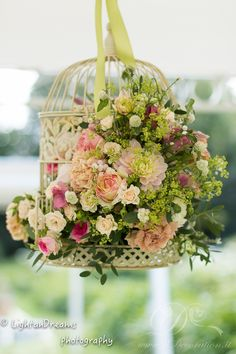 Beautiful, elegant, floral decor in a birdcage. Festoon can provide the perfect hanging space to display these from inside your Stretchtent. www.freestretch.co.uk