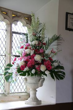 Image result for church pedestal flower arrangements