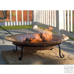 The ceremonial center of outdoor life, fire pits add warm ambience and extend entertaining into the wee hours. The deep copper basin cradles wood or coal, allowing it to burn easily and create a captivating blaze. Perfect for backyard or patio entertaining. Portable for beach or picnic!