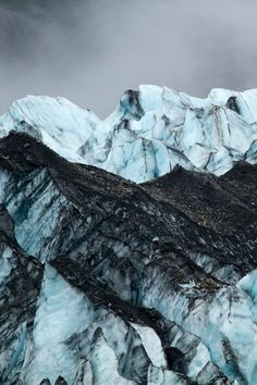 nyhx:  lightexponent:  Black and Blue on the Lamplugh Glacier, AK| Credit  this is so beautiful