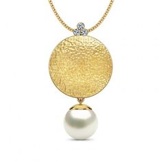 Textured and poised, the Hammered Gold Disc Pendant is made of 18K yellow gold. Accented with a round pearl below the disc and three round-cut diamonds atop, this textured pendant sums a lot of impact in a single design.