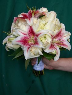 This bridal bouquet begins with a base of simple white Hydrangea. Creamy white Vendela roses are mixed with beautiful Stargazer Lilies for a splash of color and fragrance.