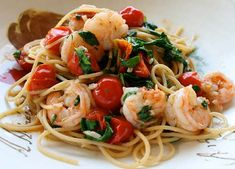 Spaghetti With Tomatoes & Chili Shrimp    Ingredients:  •••••••••••••••••••••••••••••••••••••••••••••••   1 Pound Medium Shrimp, Cleaned & Deveined  1 Pound Spaghetti  1/3 Cup Extra Virgin Olive Oil  3 Large Cloves Of Garlic, Minced  3 Dry Hot Red Chili Peppers, Crushed (Or As Desired)  4 Cups Cherry Tomatoes, Halved  3 Cups Chopped Fresh Arugula or Spinach