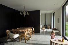 Polished Concrete Floors. Black internal wall. Vintage and personal inside a contemporary facade