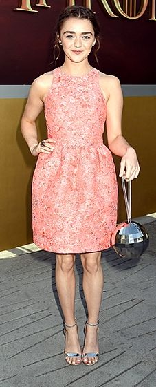 Pink lady! The GoT actress worked a salmon-hued dress by Markus Lupfer, which she accessorized with metallic sandals and a disco ball-inspired Lulu Guinness clutch.
