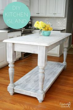 Create a marble-topped kitchen island that resembles a beautiful furniture piece.