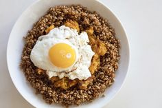 Creamy Wheat Berry Breakfast Hash Bowl with sweet potato and fried egg. Food photography and recipe by Jackie Alpers.