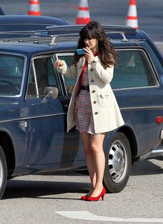 Zooey Deschanel's Striped dress with cream bow coat on New Girl.  Outfit details: http://wwzdw.com/z/1706/