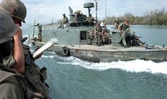 """The Brown Water Navy 1969 - two 50-foot aluminum boats, which previously had only operated on coastal surveillance missions, were added river patrol boats whose 31-foot fiberglass hull can hit 27 miles per hour in water just over nine inches deep. And from the river assault forces came the assault support patrol boats, armored troop carriers and LCM monitors — the """"heavies"""" which look for all the world like a line of ironclads on the Mississippi as they head up the Vam Co Dong."""