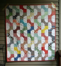 Bowtie Quilt for boys with a tutorial on this page: http://twinfibers.blogspot.com/2011/11/bow-tie-block-tutorial.html