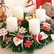 red and white cookies around candles