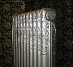 Celtic band radiator with a 'thistle' like pattern shown here with a painted grey bronze finish. This radiator has been fully restored and is ready to go