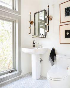 Apparatus Studio Vanity Sconces and marble hex tiles