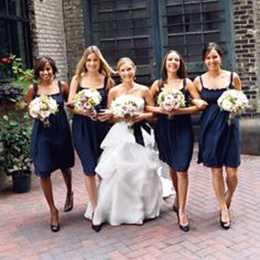 Navy bridesmaids dresses, same color but different styles