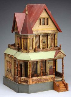 "Bliss dollhouse 1896 Large three-story Victorian house has outstanding features such as turned porch columns, gables and a side cupola, upper side porch, and three doors. Outside paper is original but stained and missing in some places. Original windows and curtains (missing chimney). Original inside paper but some staining and loss. Very imposing house! Condition (Fair). Size 25 - 3/4"" x 14"" x 14"""