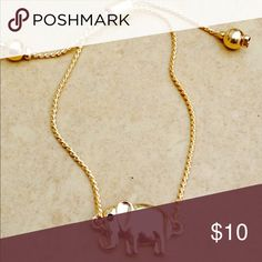 Gold Tone Adjustable Lucky Elephant Bracelet Gold tone polished finish bracelet features a lucky elephant attached at the center of a chic chain with a sliding tension clasp that makes this adjustable bracelet one size fits most.  Elephant measures 1/2 inch L x 7/8 inch W. Jewelry Bracelets