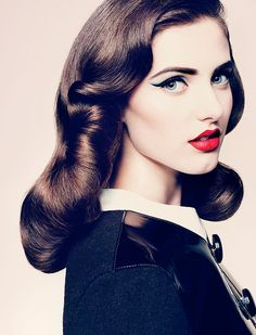 blue liquid liner, late 40s hair, red lips, cat eyes