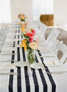 Nautical striped table runner, perfect nod to Groom's Navy career! | Photography: Summer Street Photography - www.summerstreetphotography.com  Read More: http://www.stylemepretty.com/2014/06/10/rustic-meets-preppy-vineyard-wedding-at-rosedale-farms-by-summer-street-photography/