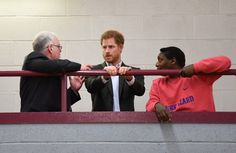 Prince Harry Photos Photos - Prince Harry (C) with Ady Hinds,(R) founder of Pink Lizard and mentor Steve White during a visit to a sports session organised by the Pink Lizard youth organisation, on the Saffron Lane estate on March 21, 2017 in Leicester, England. - Prince Harry Visits Leicester