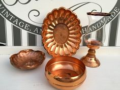 Excited to share this item from my #etsy shop: Vintage Copper, MCM Copper 5 Piece Decorative Set, Signed Gregorian Piece, Copper Craft Planter, Candle Holder with Hurricane, Etched Sc #coppercollection #vintagecopper #copperhurricane #coppercandlestick #copperplanter #coppercraftguild #gregoriancopper #interiordecorating #copperfall