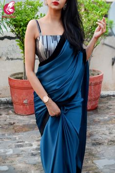 saree styles Buy Teal Blue Silk Georgette Black Velvet Taping Saree by Colorauction - Online shopping for Sarees in India Party Wear Indian Dresses, Dress Indian Style, Indian Fashion Dresses, Indian Designer Outfits, Indian Wear, Saree Designs Party Wear, Saree Blouse Designs, Black Blouse Designs, Black Velvet