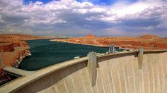 Stock Footage |Wide shot time lapse clouds in blue sky over Hoover Dam and Lake Mead on border of Nevada   Arizona | License and download using the VidLib iOS app with over 100.000 Royalty Free Clips