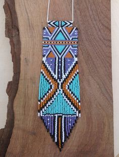 Every item of WILD MINT jewelry is hand woven using size 11 Delica seed beads. Nymo thread used for weaving and the fringe. 27 inch sterling