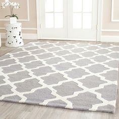 Love this rug, would match most room styles. It's neutral but cool.