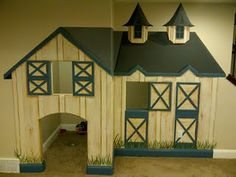 Barn playhouse under the stairs.
