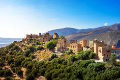 Located on the Mani peninsula, in Peloponnese, it is a settlement lost in the mountains. With traditional tower houses, typical of the region, Vatheia gets a mystical and haunted vibe. #Vatheia #Mani #Laconia #Peloponnese #Greece #Monterrasol #travel #privatetours #customizedtours #multidaytours #roadtrips #travelwithus #tour #landscape #nature #architecture #mountains #summer #beauty #beautiful #thisisgreece #tourism #destination  Tower House, Greece Travel, Day Tours, Tourism, Road Trip, Europe, River, Explore, Landscape