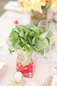 Floral centerpiece of Radishes with watercress Jmflora.com   photo:  http://withlov3.com  