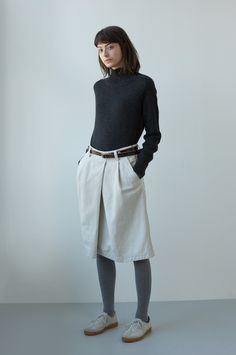 AUTUMN WINTER 2017 – CHARCOAL BRITISH MERINO SADDLE SLEEVE ROLL NECK, PUTTY RAISED COTTON DRILL OVERALL SKIRT, DARK BROWN LEATHER 2 STUD BELT, SILVER COTTON RIB TIGHTS, PUTTY NUBUCK ARMY TRAINER