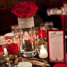 gorgeous red roses in glass vase with a ribbon of bling via Madeline's Weddings and Events in Canada on Brenda's Wedding Blog Vendor Guide www.brendasweddingblog.com