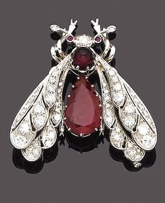 A ruby and diamond brooch Modelled as a fly, with a cabochon and pear-shaped mixed-cut ruby body and brilliant-cut diamond wings, with single-cut diamond antennae and ruby eyes, diamonds approx. 2.00ct. total, length 4.8cm