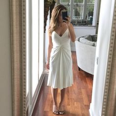 Nicole Miller collection silk ivory dress 4 Figure flattering Nicole Miller collection dress.  Body is a crepe/matte like silk with straps and accents at top in a more satin finish silk.  Very high quality and looks so expensive.  Great for spring time events.  Size 4 - freshly dry cleaned and ready for new owner Nicole Miller Dresses Midi