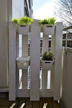 Pallet wood is god for huge as well as small spaces. If you are looking for giving a natural and lush green effect to your balcony or small terrace, then go for the following idea. Nail in the dismantled pallet wood planks. Paint them white to dominate the bright colored plants. Hang the planters and enjoy the very sight of your own hanging garden.