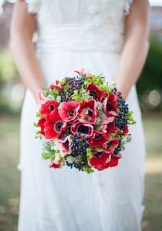 Flowers- Hand tied bouquet of red anemones and blue privet berries