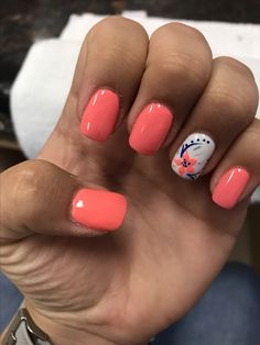 Coral and white flower nails
