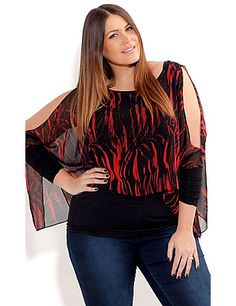 Make a statement in this color Slash Top. This stretchy knit top features a sheer & stylish chiffon over lay with a sassy red slash print. sonsi.com