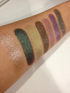 NEW Moondust Eyeshadows from left to right: Space Cowboy, Zodiac, Stargazer, Diamond Dog, Glitter Rock, Intergalactic and Moonspoon.