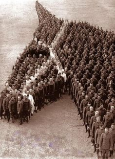 1918 ~ American soldiers paying tribute to all the horses that lost their life in World War I.