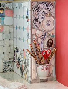 Fantastic use of old or damaged plates and cups.  Eclectic  by Tracey Stephens Interior Design Inc