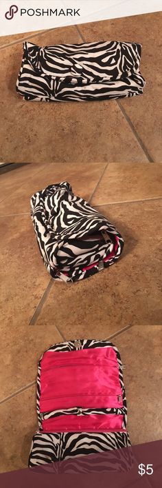 "Zebra and Pink Jewelry Roll Zebra and Pink Jewelry Roll. Has 4 pockets and a ring holder. Rolls and snaps shut. Unrolled:  11"" tall and 7.5"" wide. Rolled: 3"" tall and 7,5"" wide. Once Upon a Rose Jewelry"