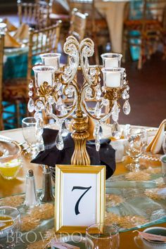 Gold candelabra centerpiece at wedding reception from Victorian Party Rentals in St. Louis Park, MN