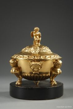 A late 19th century gilded bronze and marble tidy