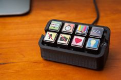 """I've been doing a little streaming on Twitch (hiya!), and a lot of streamers I follow have something called an Elgato Stream Deck. The Stream Deck is a small device with 15 buttons, each of which has its own customizable RGB icon. By configuring the bundled software, users can set button icons and macros to … Continue reading """"Building a DIY Stream Deck (Mini Macro Keyboard)"""""""
